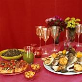 Buffet with bruschetta, fried sea bass & mountain lentils