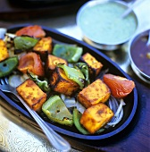 Roasted sweet potatoes, peppers and tomatoes