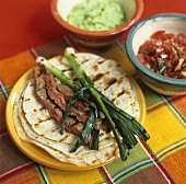 Wheat tortilla with beef and spring onions