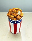 Chicken nuggets in paper cup with US colours