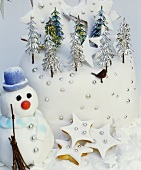 Decorated Christmas cake, star biscuits, snowman