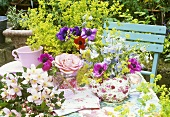 Table decoration of anemones and delphiniums in a teapot