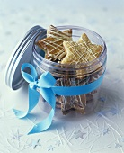 Filled, star-shaped butter biscuits in glass jar