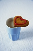 Heart-shaped biscuit with coffee