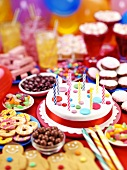 Party buffet with birthday cake, sweets, biscuits etc.