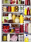Various foods and drinks in a refrigerator