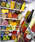 View into a refrigerator full of food