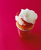 Sorbet in a paper cup against a red background