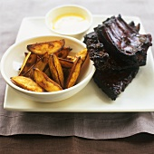 Spare ribs with honey and soya marinade and potato wedges
