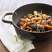Sausage and carrot stew with red onions and rosemary