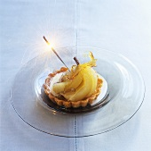 Pear and almond tartlet with spun sugar and sparkler