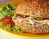 Sliced chicken breast in wholemeal roll
