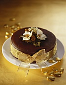 Chocolate cake with gold bow for Christmas