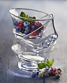 Frozen berries in stacked glass bowls