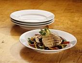 Grilled swordfish on grilled vegetables