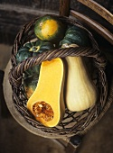 Assorted squashes in a wicker basket (overhead view)