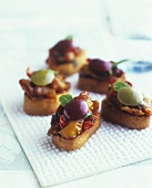 Small toasts topped with marinated vegetables