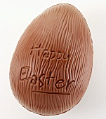 Chocolate egg with the words 'Happy Easter'