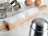 Still life with rolling pin, flour, cutters, eggs