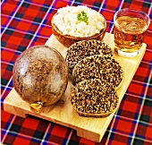 Haggis, mashed turnips and a glass of whisky (Scotland)