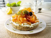 Bagel topped with cream cheese and smoked salmon