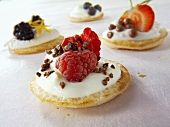 Sweets blinis with crème fraîche, raspberries & pieces of chocolate