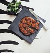 'Tarte Tatin' style cherry tomato tart (grainy effect)