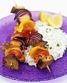 Smoked tofu and vegetable kebabs on rice