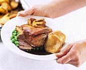 Roast beef with Yorkshire pudding and vegetables