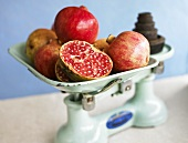 Pomegranates on kitchen scales