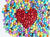 Coloured chocolate beans with red heart