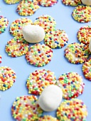 White gems (white chocolate buttons with sprinkles) forming flowers