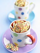 White gems (white chocolate buttons with sprinkles) in cups