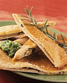 Thin strips of garlic bread with herb dip