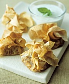 Pastry purses with vegetable filling & minted yoghurt sauce