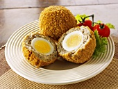 Scotch eggs (boiled eggs in sausage meat, UK) with salad