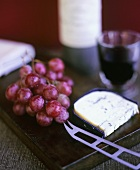 English blue cheese, red grapes and red wine