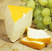 Port Salut cheese with grapes