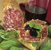 Truffle salami with fresh basil and slices of truffle