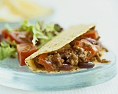Taco with chili con carne filling