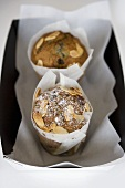 Two muffins in cardboard container