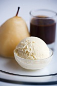 Baked pear with vanilla ice cream and chocolate sauce
