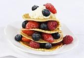 Pancake tower with fresh berries and cream