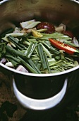 Sliced vegetables in a pan (spring onions etc.)