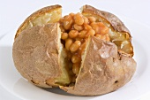 A baked potato with baked beans
