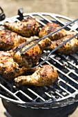 Chicken drumsticks on a barbecue