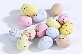 Chocolate eggs with pastel coloured sugar coating