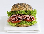 Ham and salad in a sesame and poppy seed roll