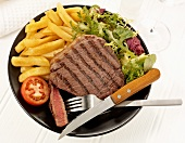 Rump steak with chips and salad garnish