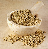 Shelled hemp seeds in a mortar